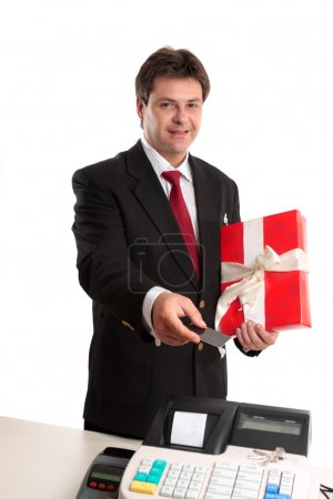Photo for A man pays for a present with debit or credit card at the checkout. - Royalty Free Image