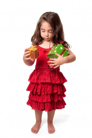 Little girl with armful of presents