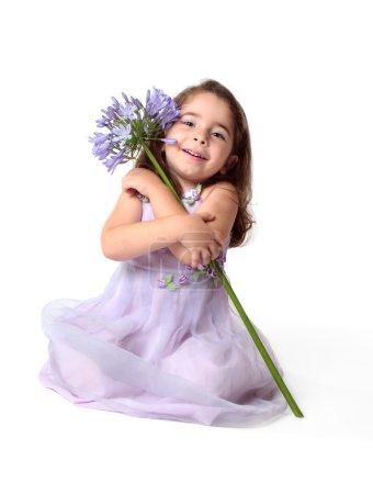 Beautiful smiling girl hug pretty flower