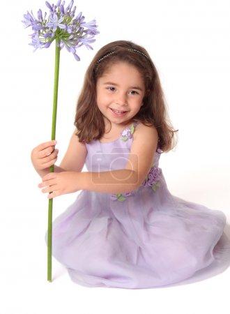 Pretty girl holding flower