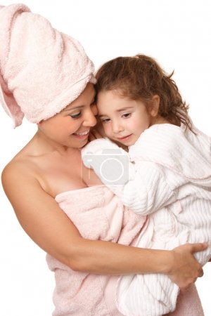 Doting mother and daughter bathtime