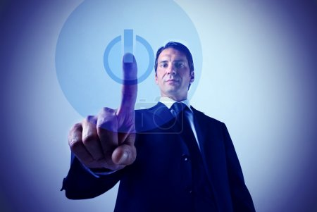 Photo for Businessman pressing the start button on a touchpad - Royalty Free Image
