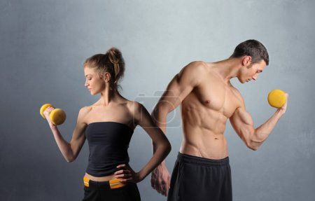 Photo for Couple lifting weights - Royalty Free Image