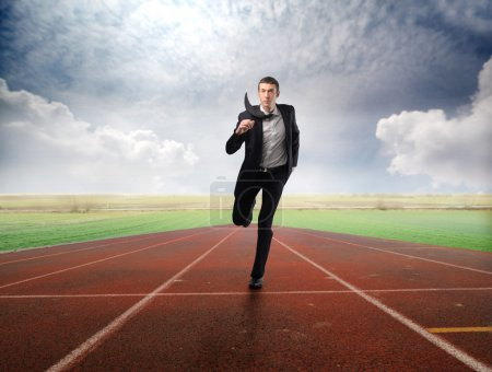 Photo for Businessman running on a running track - Royalty Free Image