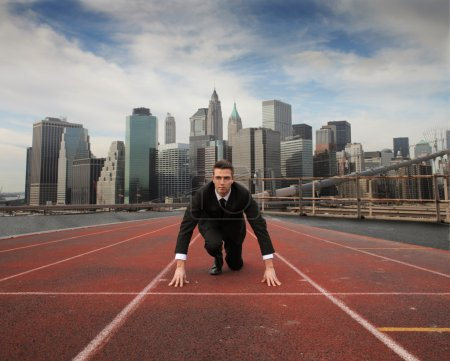 Photo for Businessman kneeling on a running track - Royalty Free Image