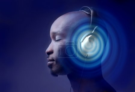 Photo for Black guy on profile listening music with earphones - Royalty Free Image
