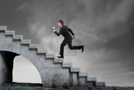 Photo for Businessman running up the stairs - Royalty Free Image
