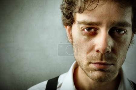 Photo for Sad young man crying - Royalty Free Image