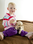 Toddler with puppy