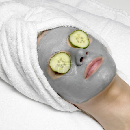 Woman with facial mask...