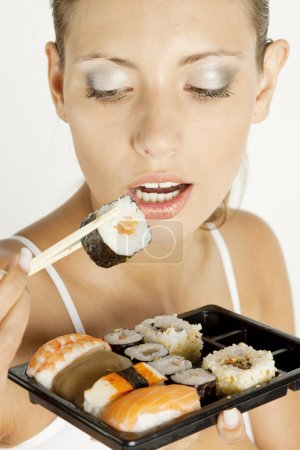 Photo for Portrait of woman with sushi - Royalty Free Image