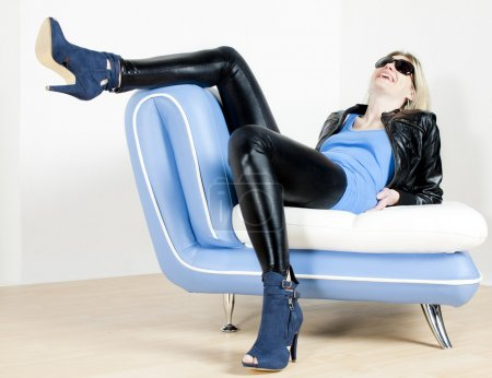 Photo for Woman wearing fashionable shoes lying on sofa - Royalty Free Image