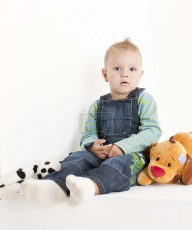 Photo for Sitting toddler with toys - Royalty Free Image
