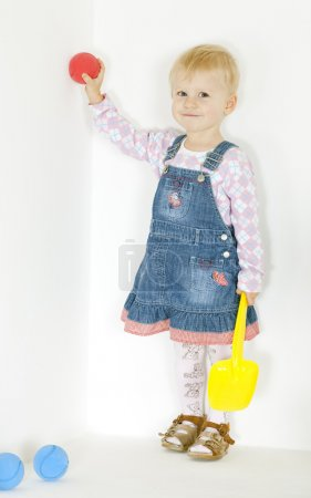 Standing toddler with balls