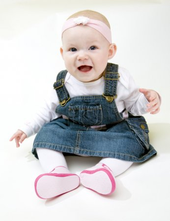 Photo for Sitting baby girl - Royalty Free Image