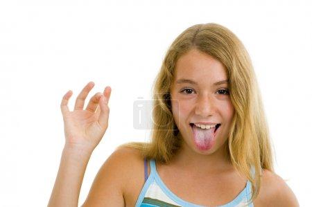 Photo pour Fille adolescente blonde montrant la langue, isolé sur blanc - image libre de droit