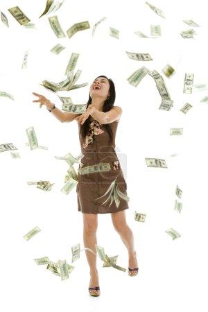 Photo pour Jolie femme jeter des billets de 100 dollars, isolés sur fond blanc - image libre de droit