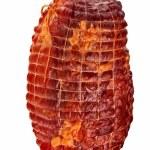 Big tasty smoked ham isolated over white backgroun...