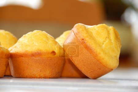 Photo for Golden fresh appetizing bakery closeup on table - Royalty Free Image