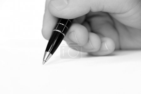 Man hand writing on white paper