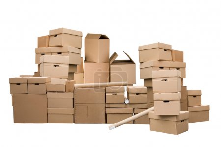 Photo for Brown different cardboard boxes arranged in stack on white background - Royalty Free Image