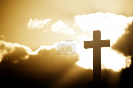 Photo for Silhouette of a cross in beams of light - Royalty Free Image