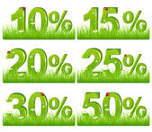 Set Of Green Discount Figures In Grass For Your Design Isolated on white