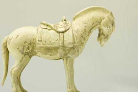 Pottery horse in glaze