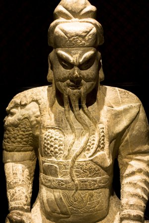 Chinese sculpture man in black background