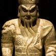 Chinese sculpture man in black background,it is to...