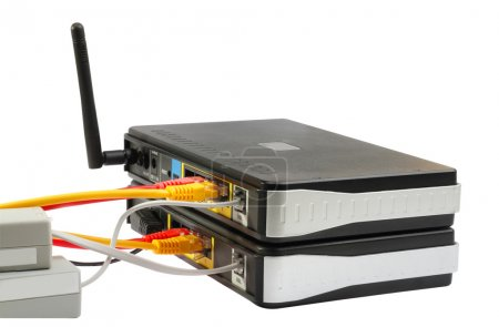 Wireless Routers and Networking Cable. White backg...