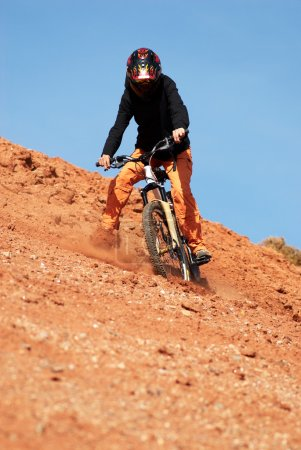 Girl downhill on red loam hills