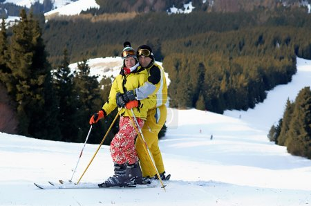 Photo for Yong family skiers in yellow on ski slope - Royalty Free Image
