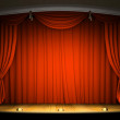 Empty stage with red curtain in expectation of per...
