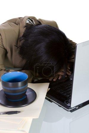 College Student Sleeping on her Desk