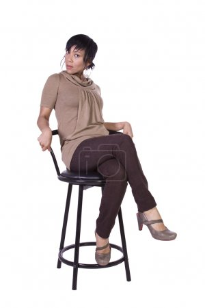 Photo for Beautiful Woman Posing on a Chair - Isolated White Background - Royalty Free Image