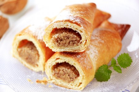 Photo for Sweet pastry rolls with nut filling - detail - Royalty Free Image