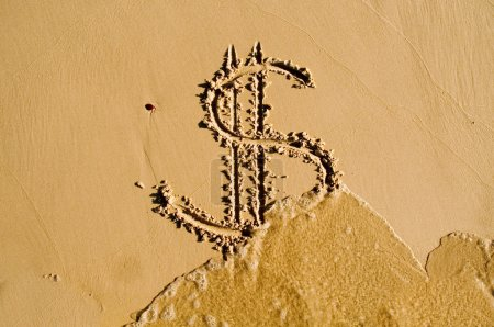 Dollar sign drawn in the sand