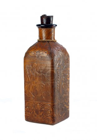 One vintage leather covered decorative liquor bottle on white.