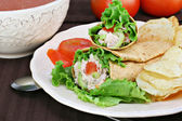 Tuna salad wraps, chips and tomato soup.