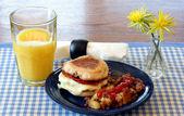 English muffine, egg, cheese breakfast.