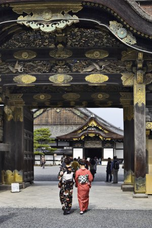 Women in kimono enters to Nijo castle