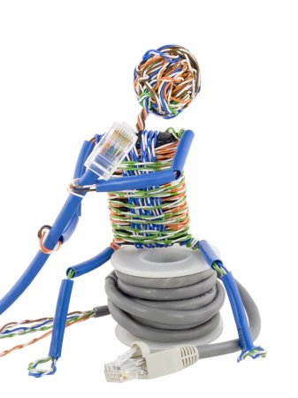 Twisted man looks on patch cable