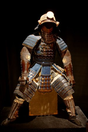 Historic samurai armor on black...