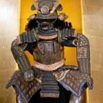 Historic samurai armor on yellow...
