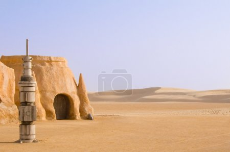 Photo for Abandoned sets for the shooting of the movie Star Wars in the Sahara desert on a background of sand dunes. - Royalty Free Image