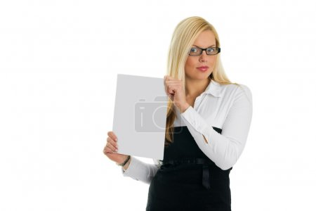 Photo for Young business women showing blank paper. Isolated on white - Royalty Free Image