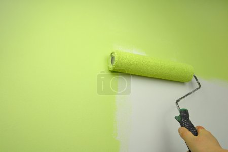 Hand painting wall in green color
