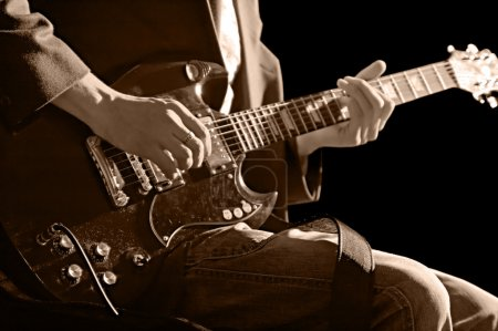 Photo for Musician with guitar isolated on black background - Royalty Free Image