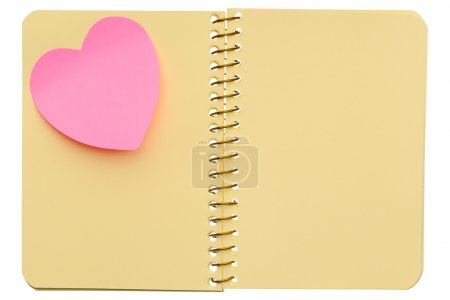 Photo for Open spiral notebook with post-it note in shape of heart isolated on white background - Royalty Free Image